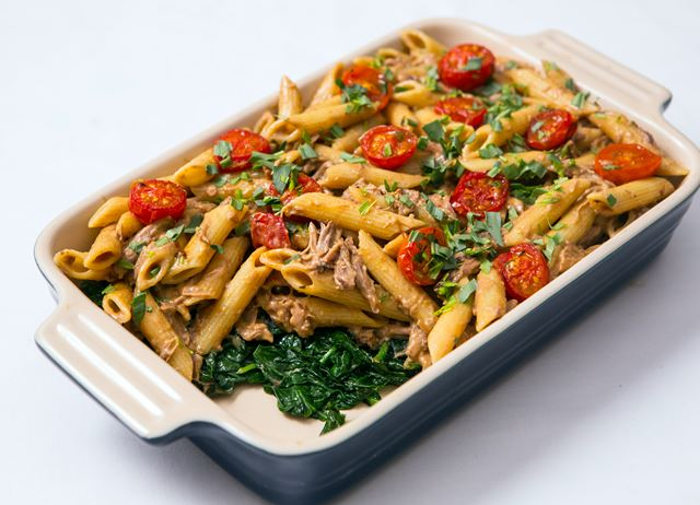 Confit duck leg with penne, spinach and tomato