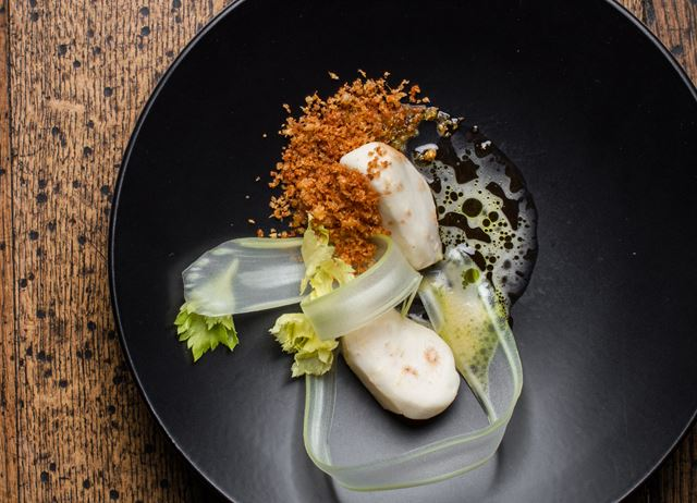Salt-baked celeriac with whey and brown butter sauce, celeriac crumbs and dill oil