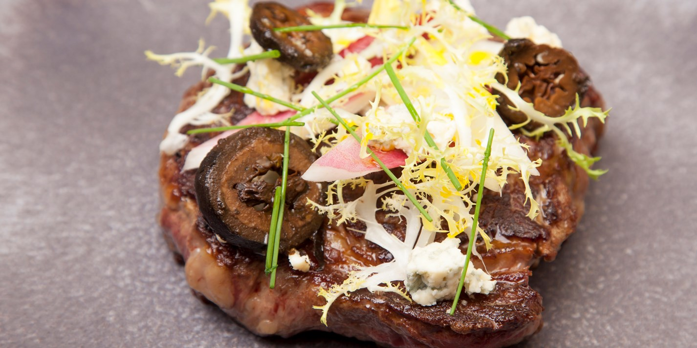 Ribeye steak with chicory, blue cheese and pickled walnuts
