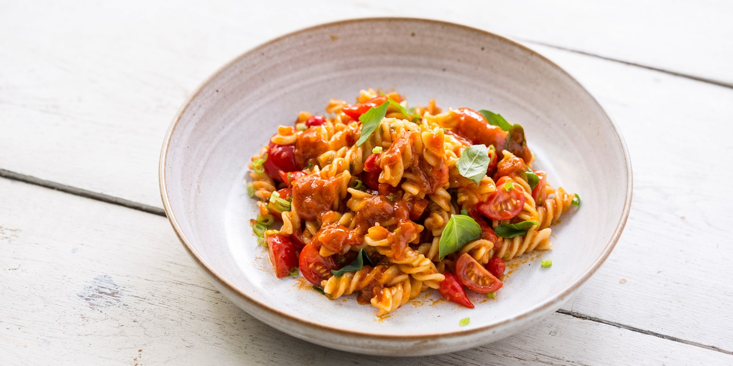 Pesto rosso fusilli with cherry tomatoes and basil