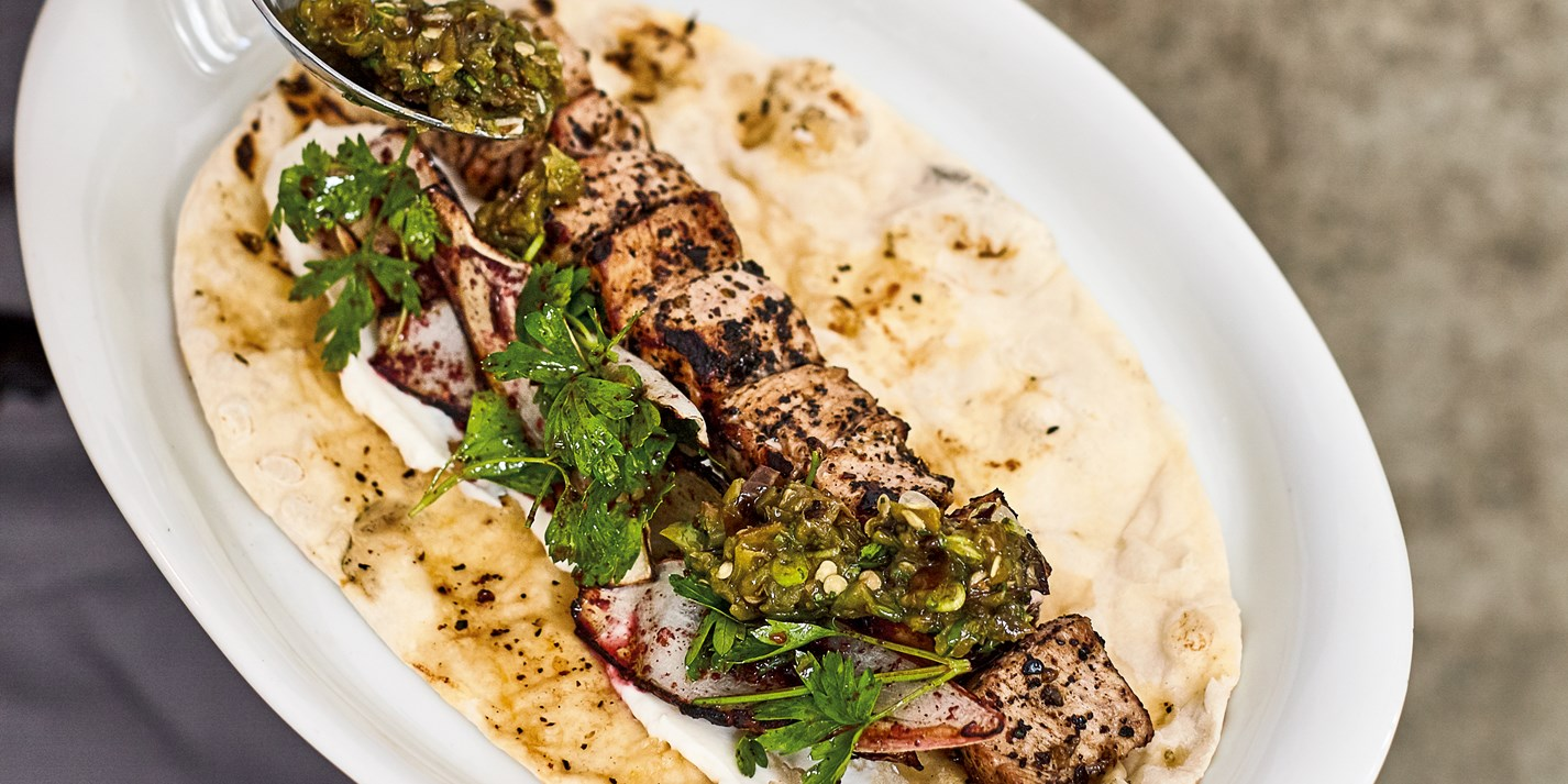 Veal shish and onion salad flat bread with charred sivri biber relish