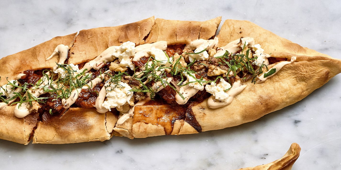 Chicken and garlic kofte pide with chilli yoghurt, smoked salsa, walnuts and feta