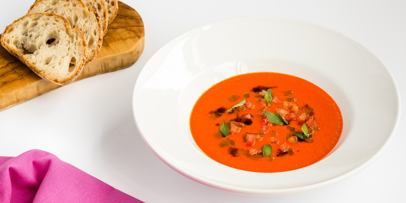 Spicy tomato soup with basil oil