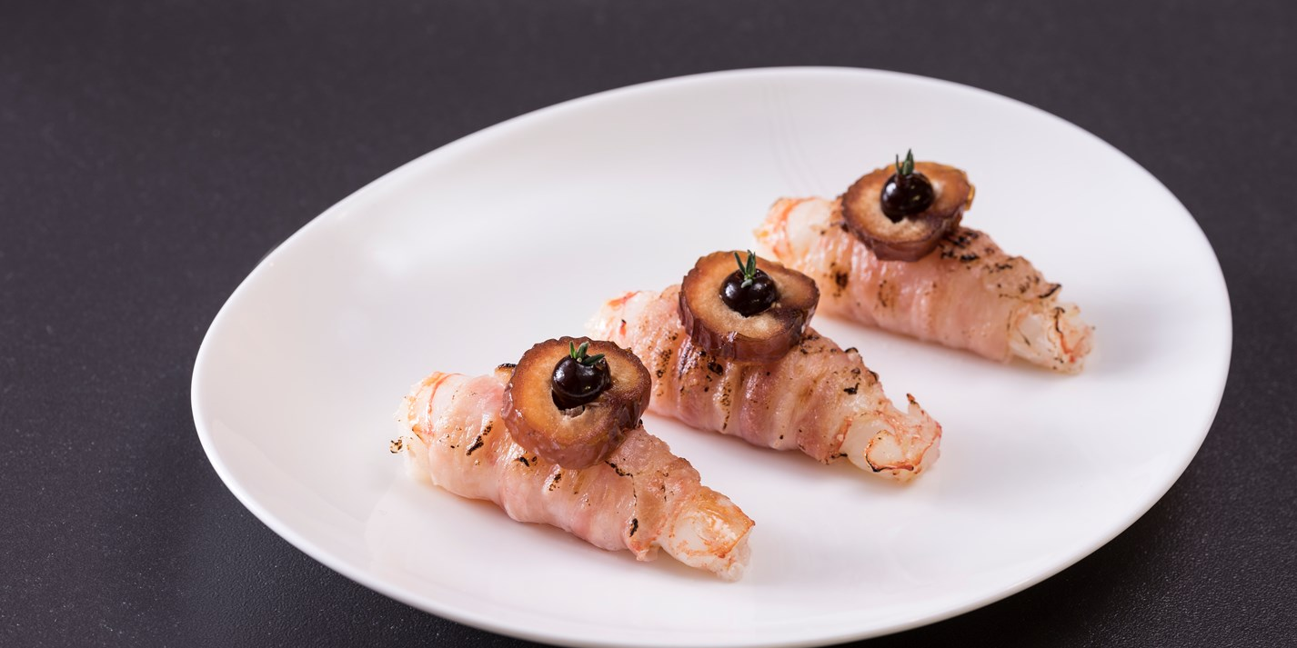 'Shrimp in mink' - langoustines wrapped in pancetta with date puree