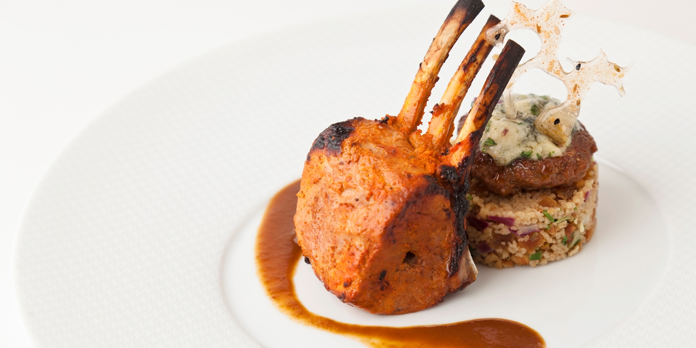 Home-smoked lamb rack with lamb jus, apricot-walnut couscous, blue cheese-lamb tikki