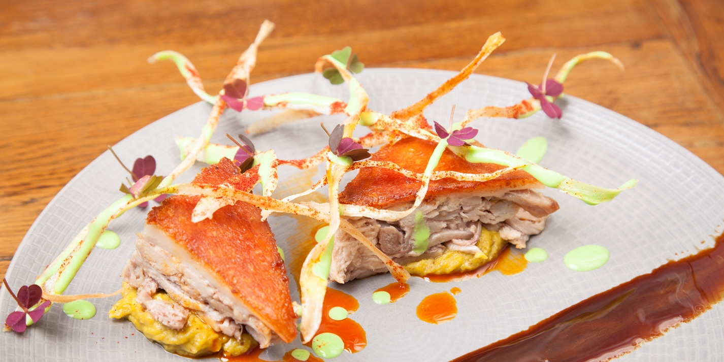 Confit suckling pig with corn purée and algarrobo syrup