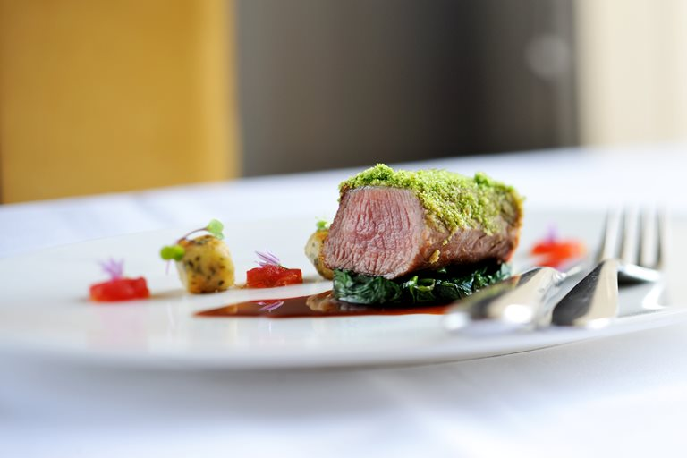 Best end of new season lamb with a pine nut and wild garlic crust and tarragon gnocchi