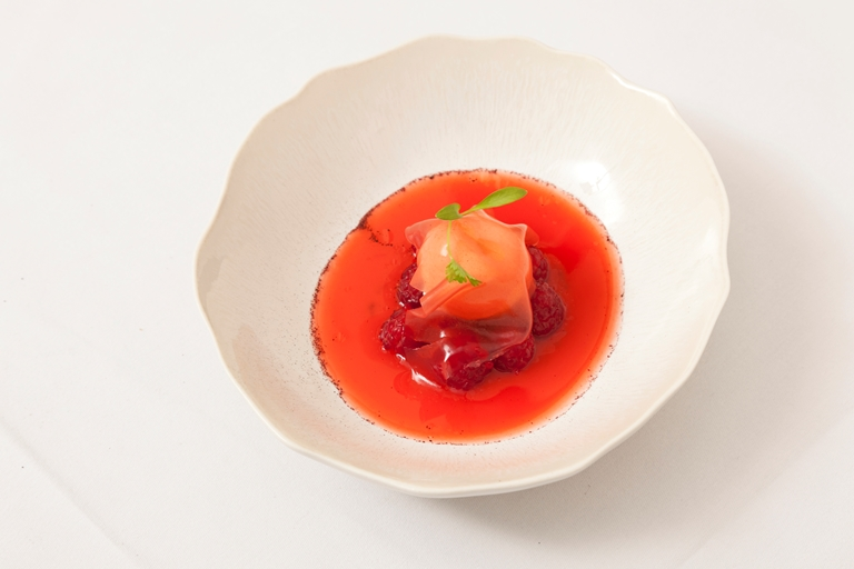 Raspberry soup with raspberry jelly and milk ice cream