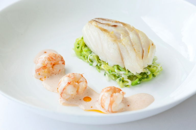 Roasted Alaska halibut with buttered leeks and langoustine bisque sauce