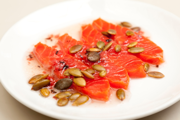 Alaska salmon sashimi, umeboshi and argan oil dressing, toasted pumpkin seeds