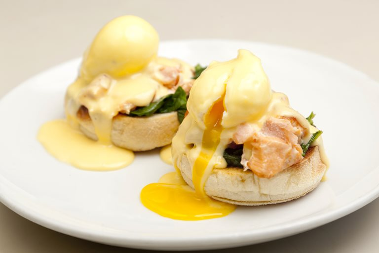 Tea-smoked Alaska salmon, poached eggs, spinach and yuzu hollandaise, English muffin