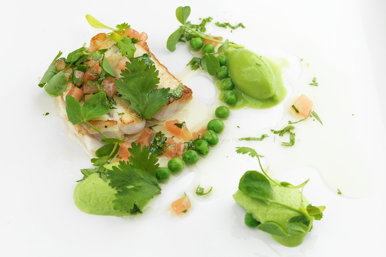 Baked Alaska halibut with pea mousse and sauce vierge