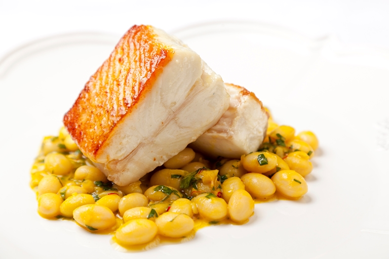 Pan-roasted Alaska halibut with coco bean, saffron and chardonnay