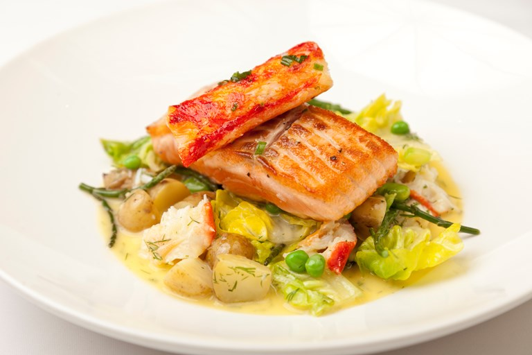 Alaska salmon with braised lettuce, potatoes, samphire and Alaska king crab