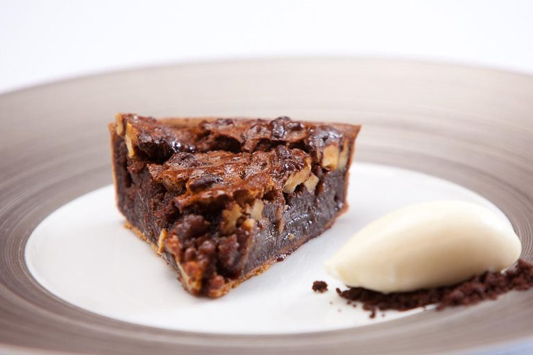 Dark chocolate and walnut tart with crème fraîche ice cream