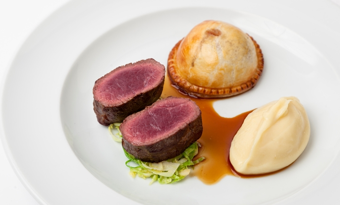 Roast loin of venison, wild mushroom pie and parsnip purée