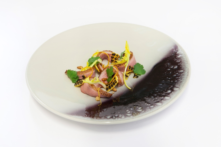 Salad of duck breast with orange, pine kernels and dandelion