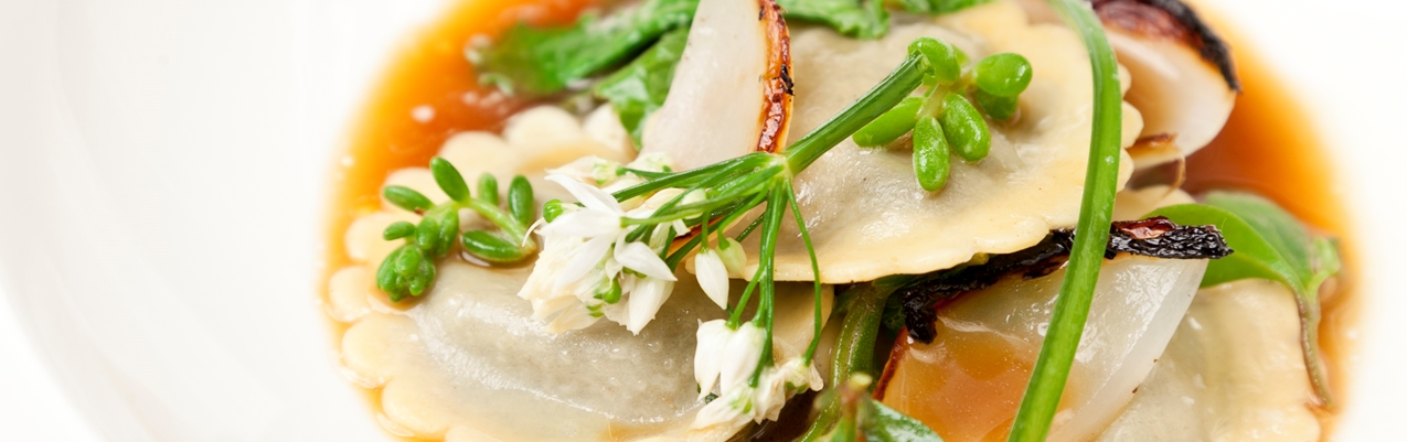 Laverbread ravioli with roasted onion stock and Welsh beach vegetables