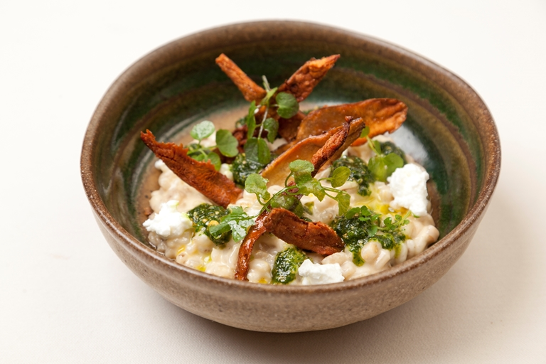 Jerusalem artichoke orzotto with parsley and peanut pesto