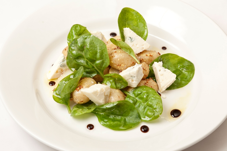 Baby spinach and new potato salad with melted Gorgonzola