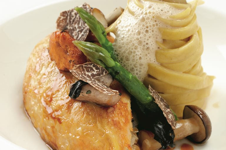 Pot-roasted maize-fed chicken with wild mushrooms, asparagus spears and truffle tagliatelle