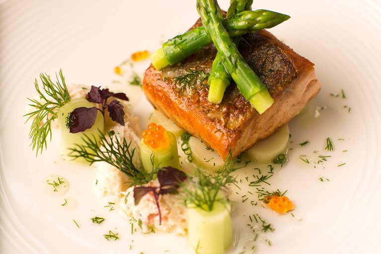 Pan-roasted fillet of salmon with marinated Jersey Royals and dill and crab salad