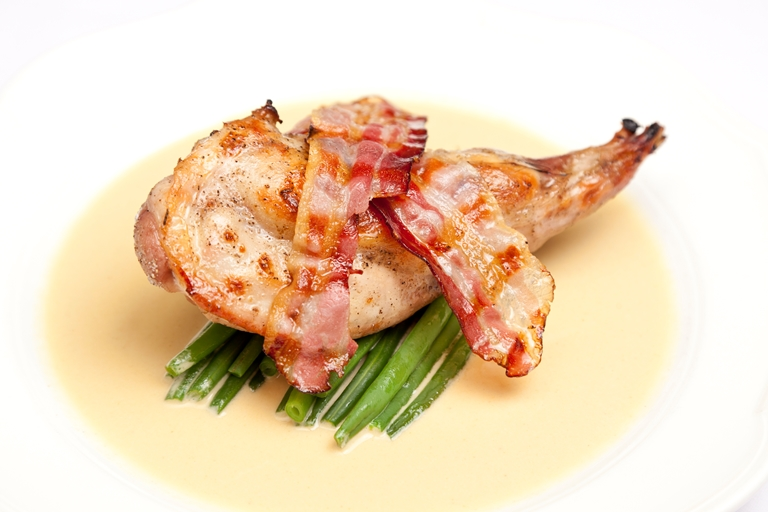 Rabbit with mustard sauce and bacon