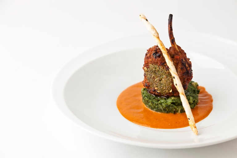 Spice-crusted lamb rack, with spinach-potatoes and moilee-tomato sauce