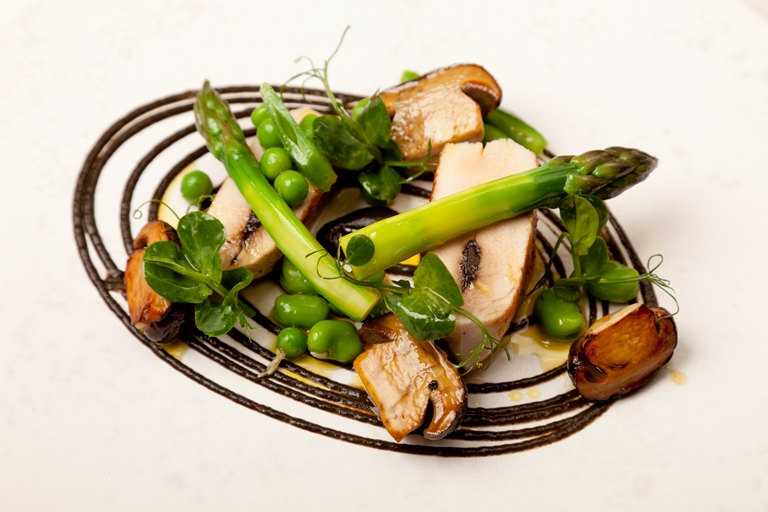 Chicken with black garlic, mushrooms and asparagus