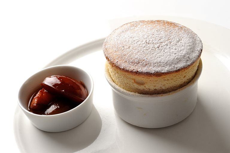 Mirabelle soufflé with poached plums