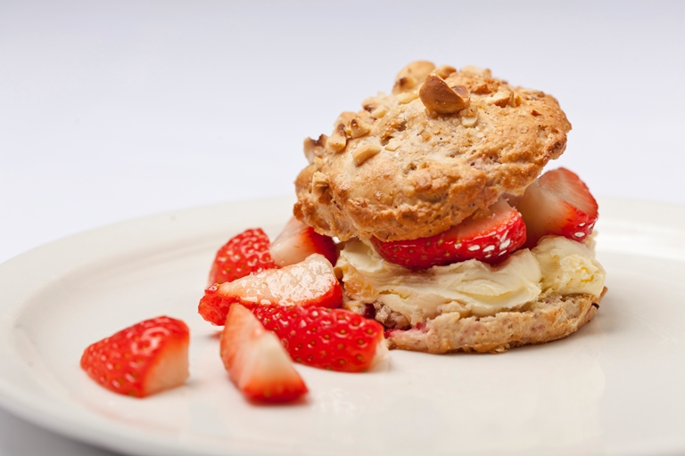 Hazelnut and tonka bean scones with strawberries and clotted cream