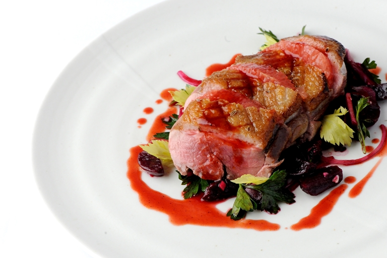 Duck breast with honey, caraway and beetroot and grapefruit salad