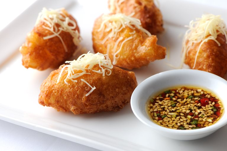 Cheddar beignets with sesame dressing