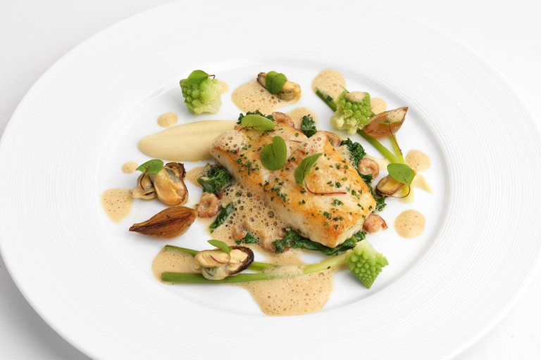 Seared turbot with celeriac, brown shrimp, mussels and shellfish velouté