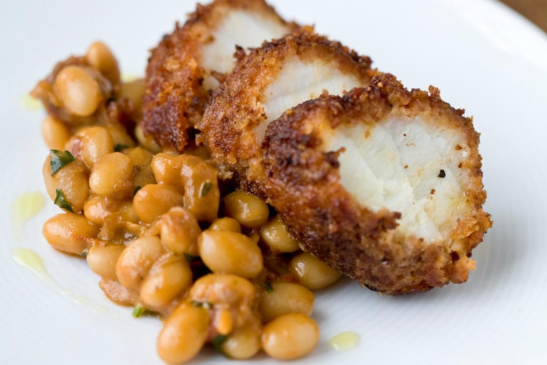 Monkfish with chorizo crust and spiced beans