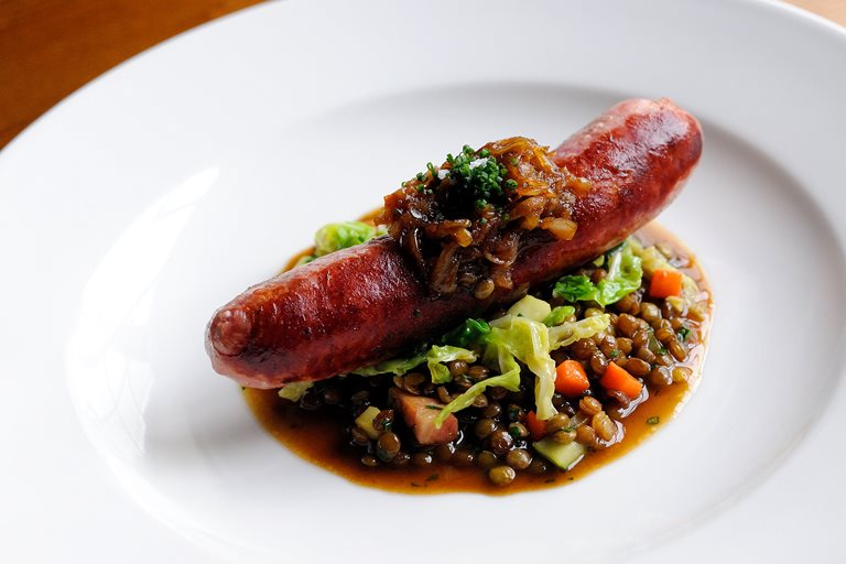 Toulouse sausage with braised lentils