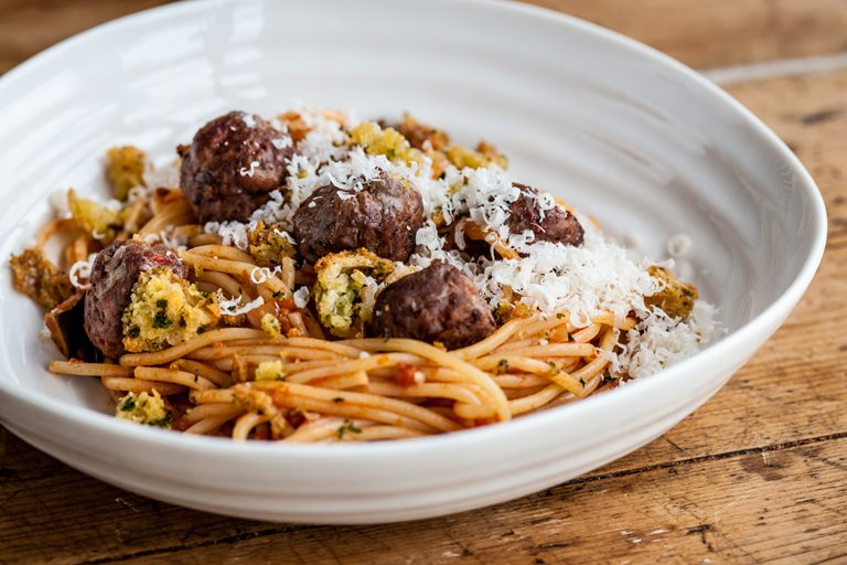 Spaghetti and meatballs with mini garlic bites