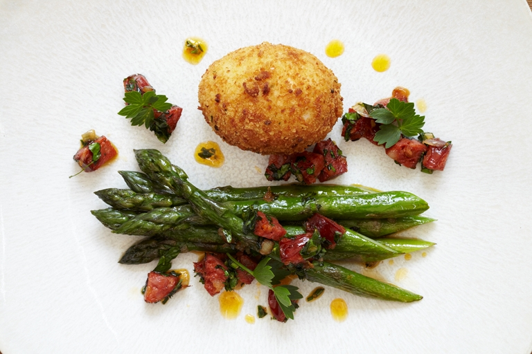 Asparagus with crispy duck egg, chorizo and lovage