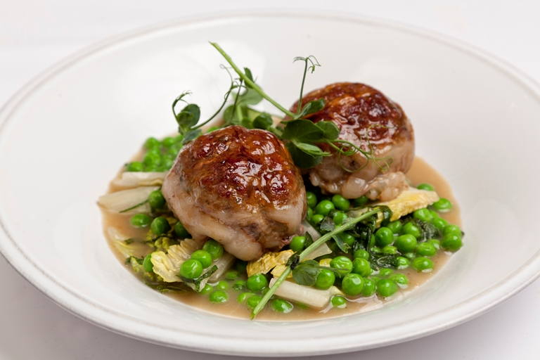 Ale-braised mutton and kidney faggots with peas, lettuce and mint