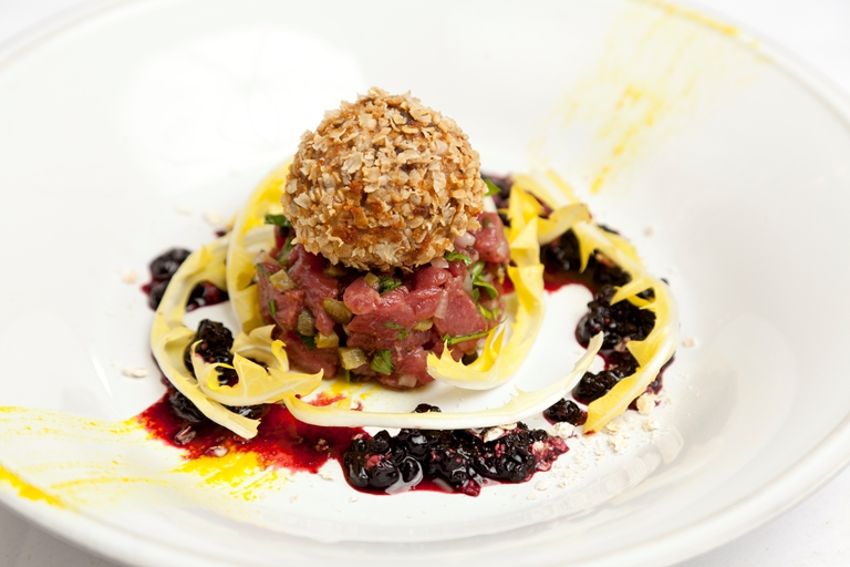 Venison tartare with haggis Scotch egg and elderberry dressing