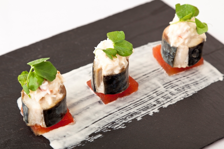 Mackerel with compressed watermelon, crab and horseradish salad