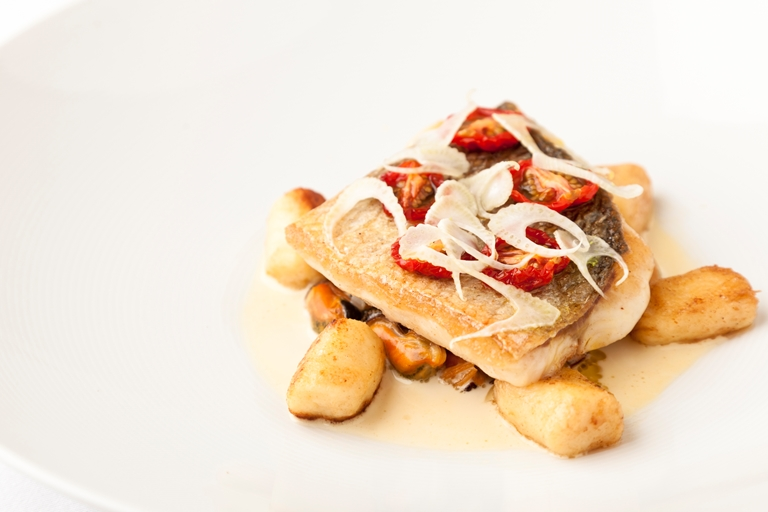 Pan-fried sea bass with Brancaster mussels, gnocchi and fennel