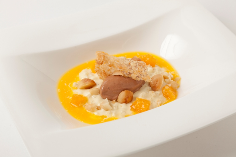 Chilled rice pudding with chocolate sorbet, mandarin soup and macadamia nut tuille