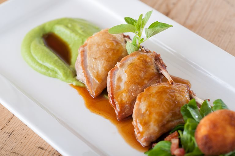 Breasts of quail with pea purée, pancetta and marjoram jus