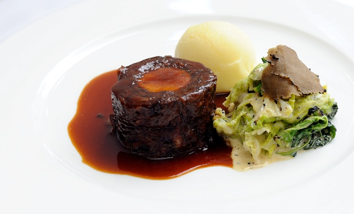Oxtail with boudin blanc and creamed cabbage