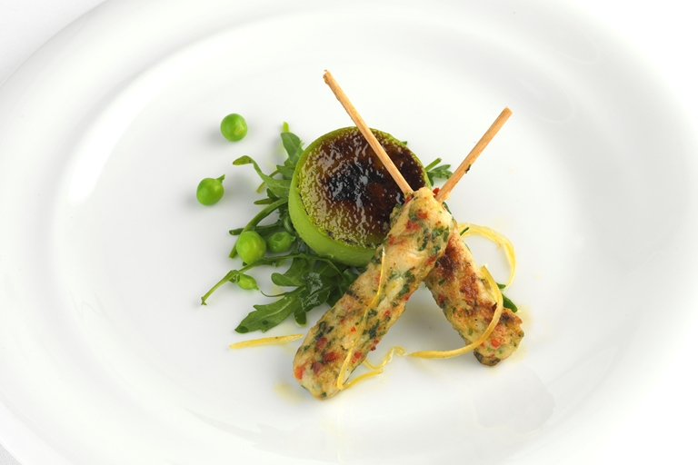 King prawn kebabs with pea brûlée and rocket