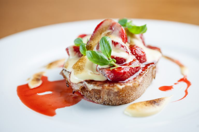 Eggy bread with pan-roast strawberries and elderflower sabayon