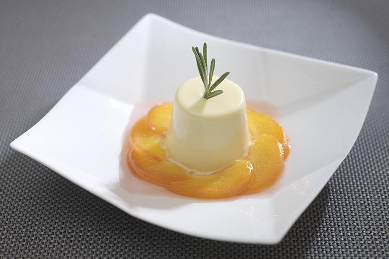 Poached peaches with rosemary cream
