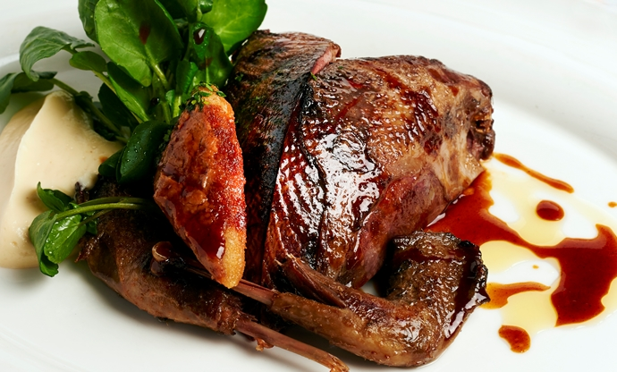 Roast grouse with game chips, watercress and bread sauce