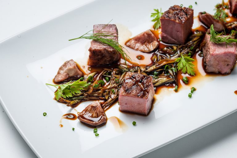 Chargrilled Gressingham duck breast with spring onion, pickled shiitake mushrooms, garden herbs and soy reduction